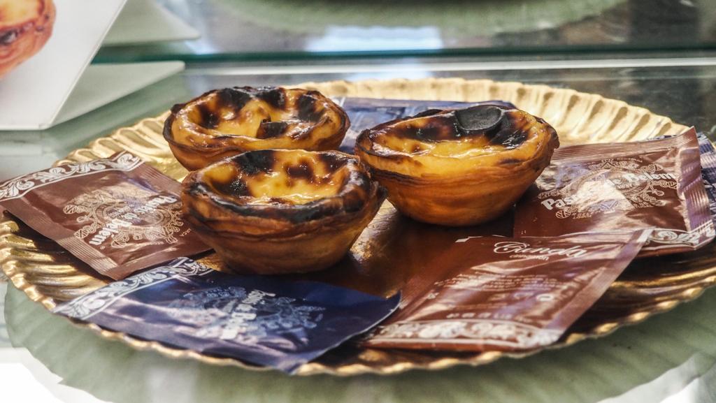 A plate of three Pastéis de Nata from Pastéis de Belém in Lisbon, Portugal