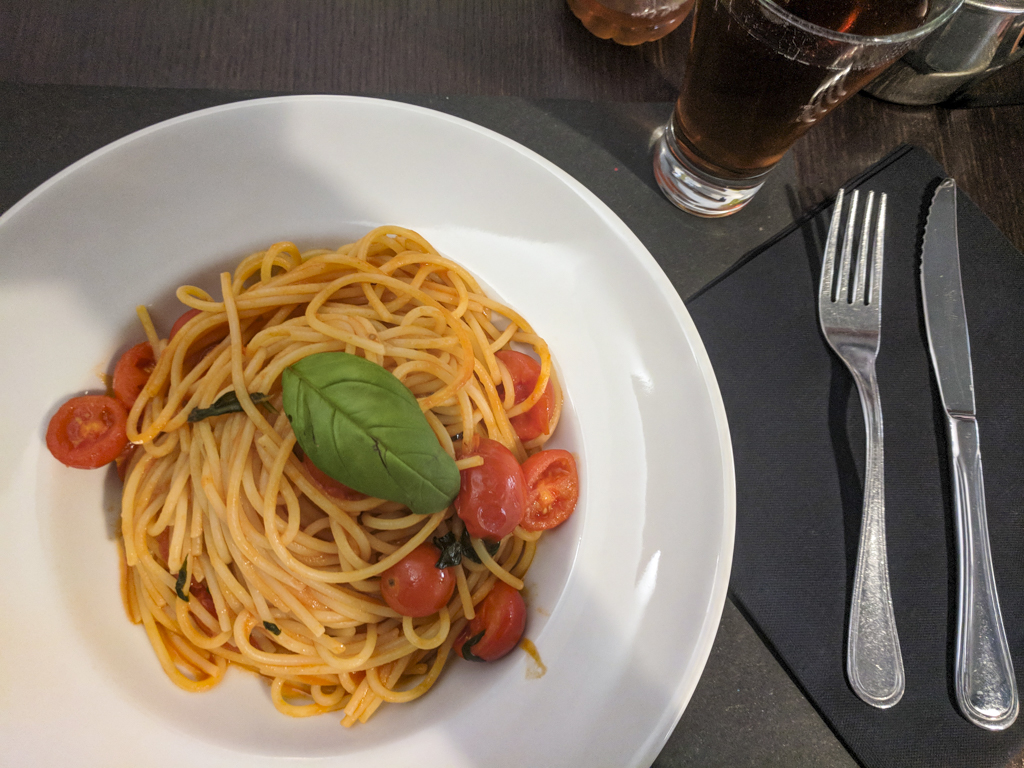 Pasta with tomatoes from a restaurant in Rome, Italy