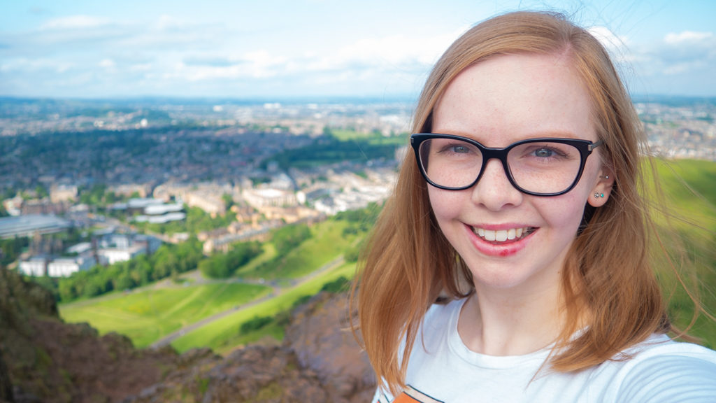 Almost Ginger blog owner on top of Arthur's Seat in Edinburgh | 3 Days in Edinburgh
