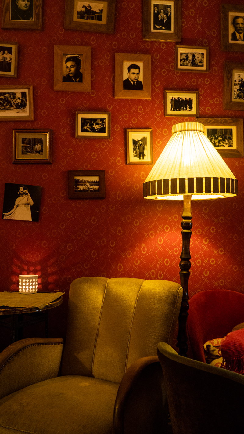 Inside Vinyl Café with a comfy green lounge chair and lamp in Wrocław, Poland, how to spend 48 Hours in Wrocław, Poland