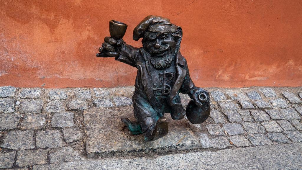 Wrocław Dwarf drinking wine in Wrocław, Poland