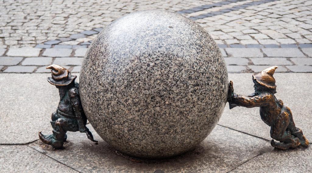 Wrocław Dwarfs trying to move a ball in Wrocław, Poland, how to spend 48 Hours in Wrocław, Poland