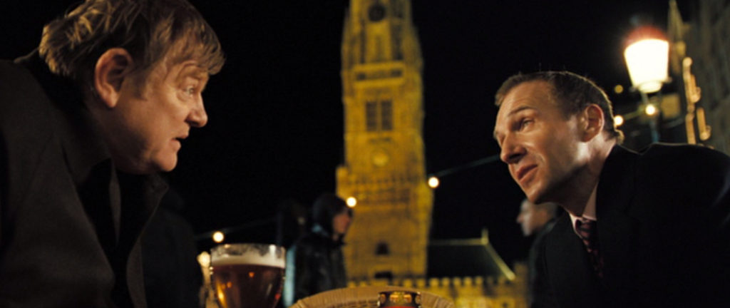 Ken (Brendan Gleeson) and Harry (Ralph Fiennes) drinking outside the Belfry, Bruges one of the In Bruges filming locations