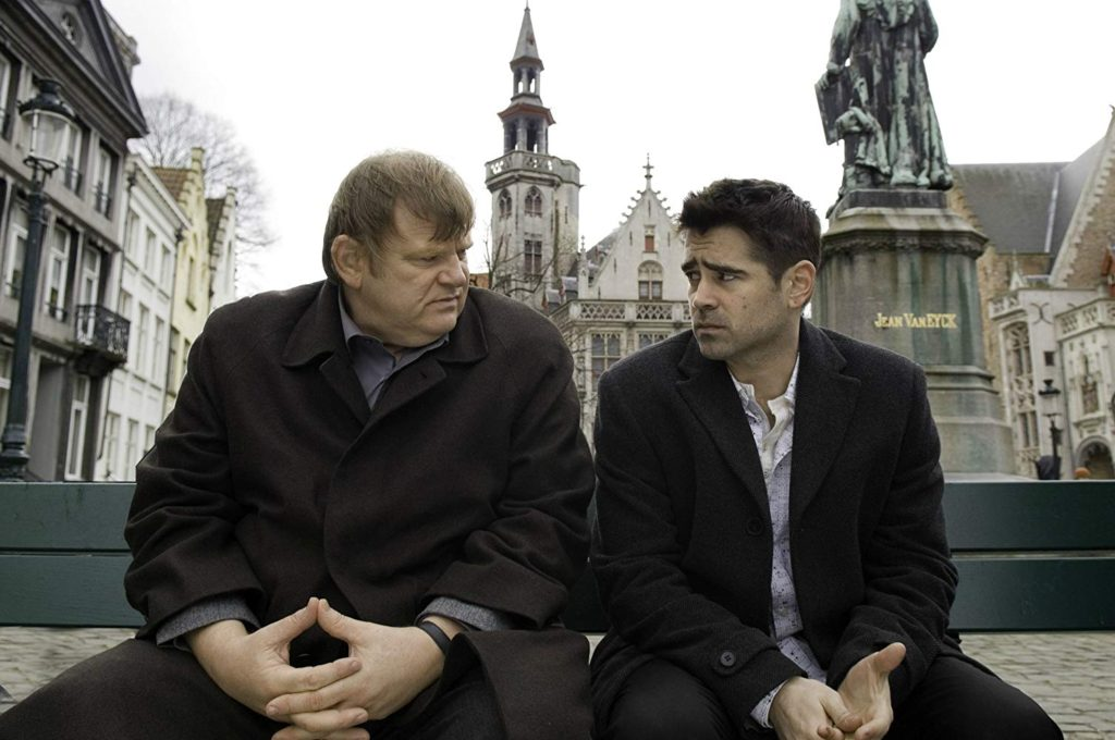 Ken (Brendan Gleeson) and Ray (Colin Farrell) talk in Jan Van Eyckplein in Bruges, Belgium one of the In Bruges filming locations