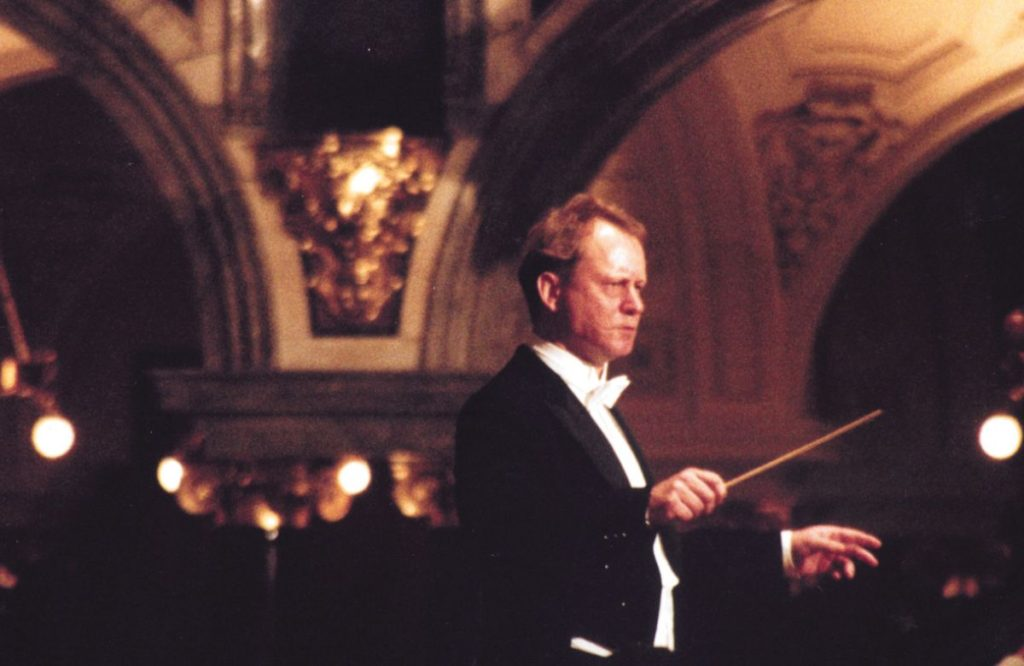 Film still from Taking Sides (2001) of a conductor in a theatre