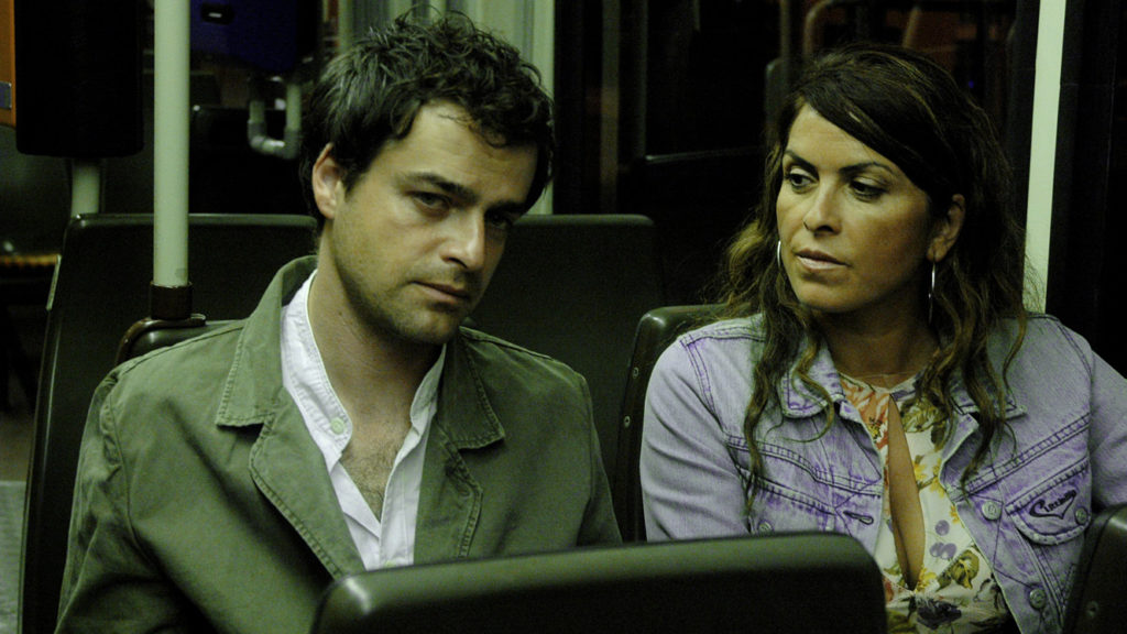 Film still from The Edge of Heaven (2007) of a man and woman on a bus