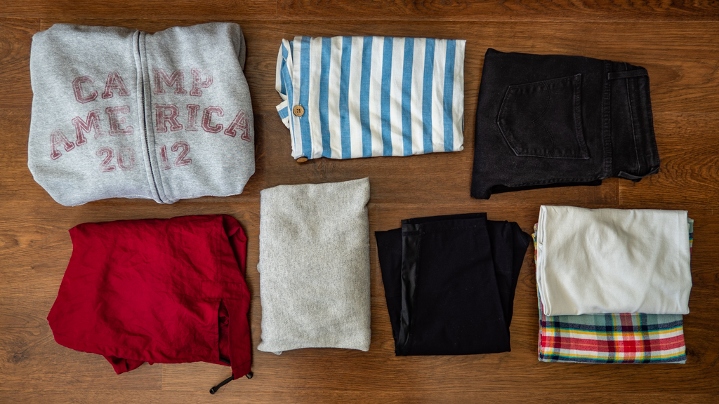 Flatlay of Camp America 2012 hoodie and other camp counsellor clothes to pack for summer camp