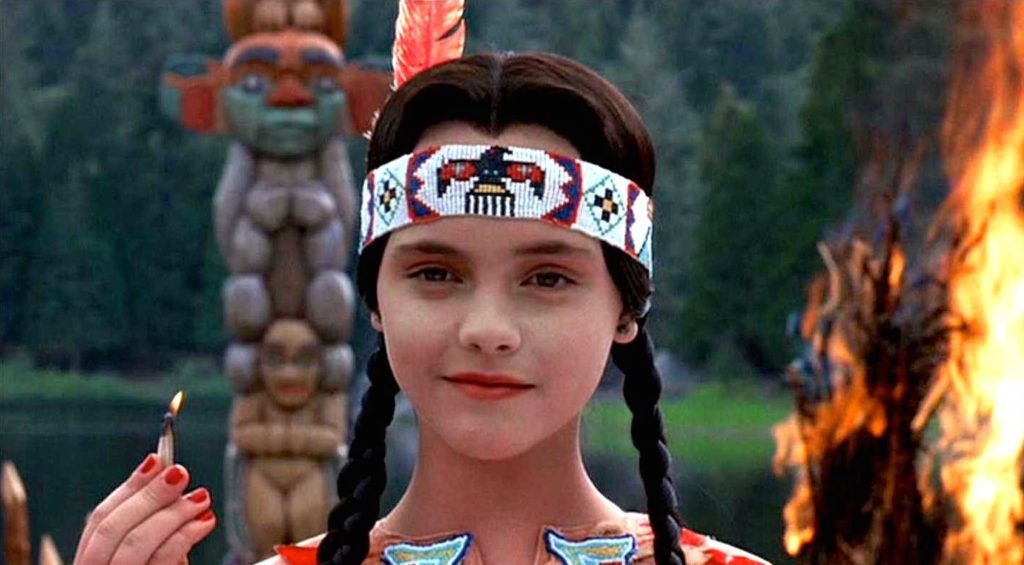 Addams Family Values (1993) film still of Wednesday Addams as a Native American in a play