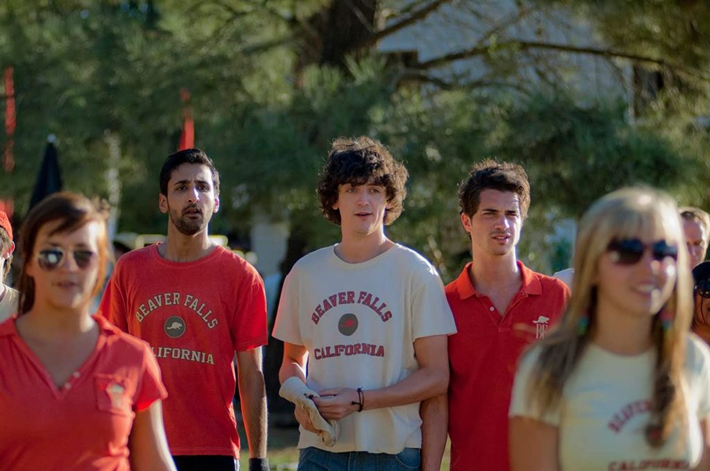 Beaver Falls (2011-2012) TV show still with three male camp counsellors in uniform outside