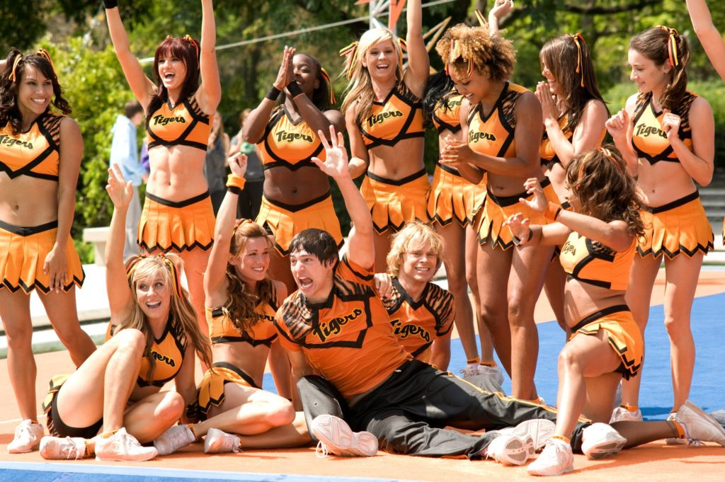 Fired Up (2009) film still featuring a group of female cheerleaders and two male cheerleaders posing
