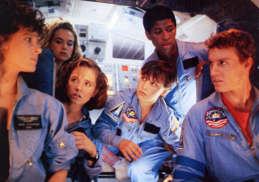 SpaceCamp (1986) film still featuring six astronaut campers in blue uniforms