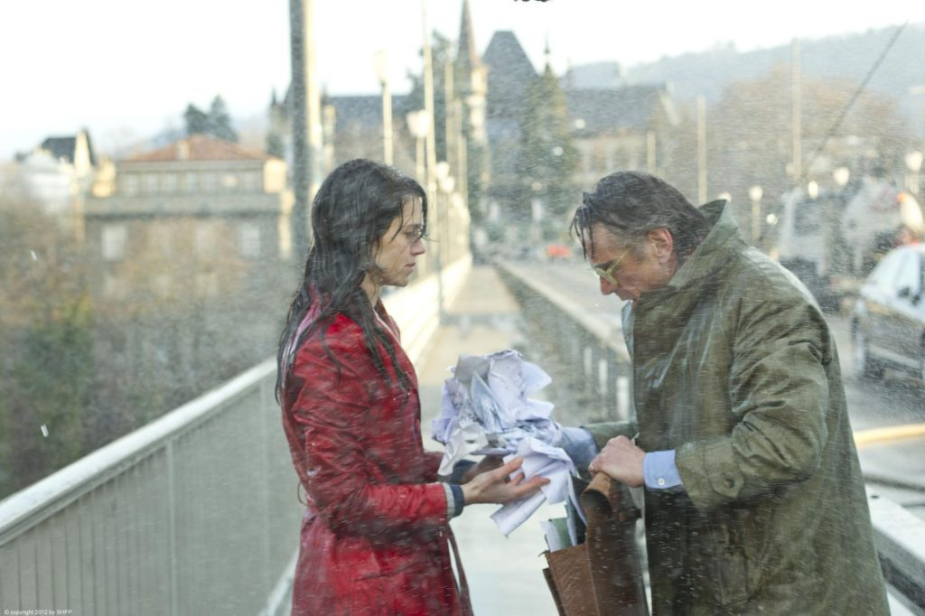 Still of a man and woman soaking wet from the film Night Train to Lisbon (2013)