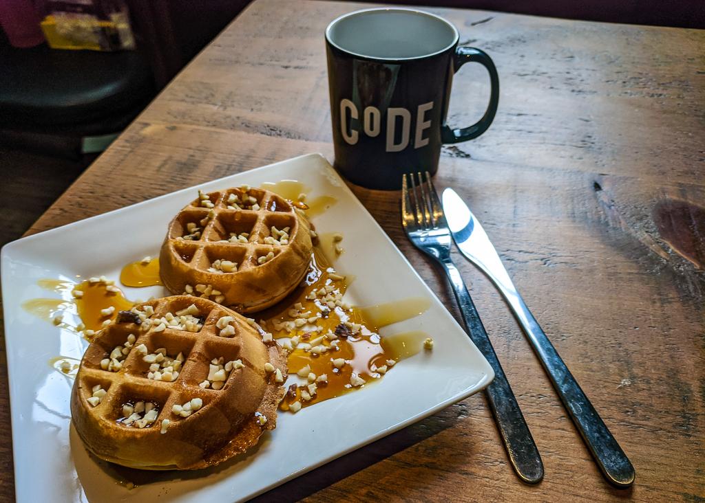 Waffles and CoDE Hostel mug in Edinburgh, Scotland