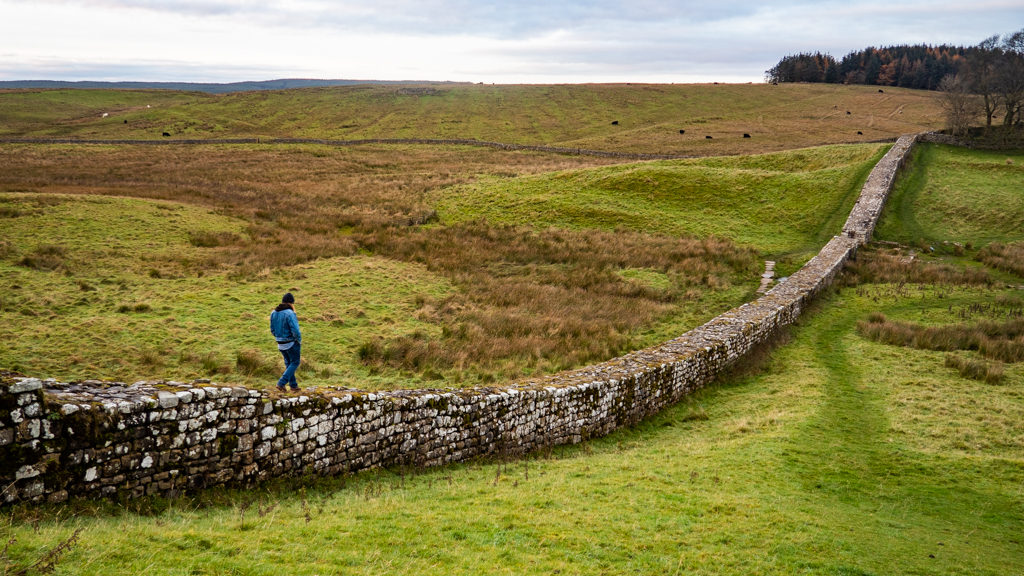 Man walking along Hadrian's Wall in Hexham, Northumberland in England